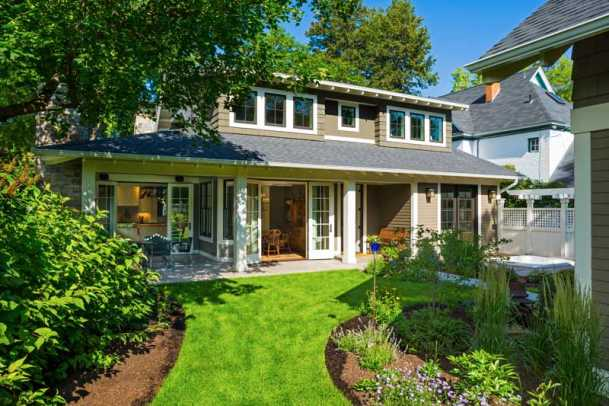 The architect used an Arts & Crafts vocabulary with a modern vernacular, creating a successful infill bungalow.
