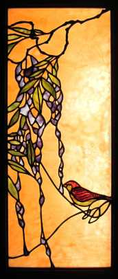 Stained-glass panel 'Bird and Wisteria' is by San Francisco Bay area glass artist  Theodore Ellison.