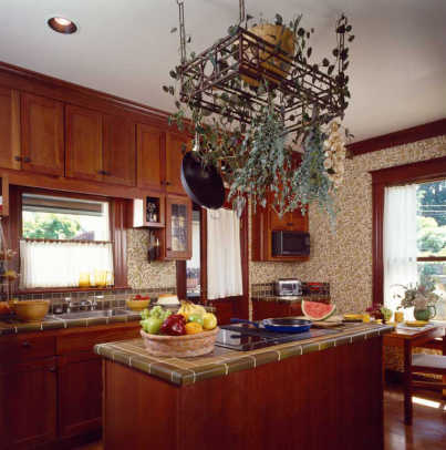 The renovated kitchen includes a center island, tiled to match countertops.