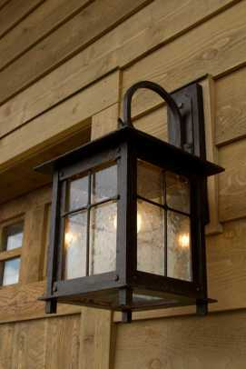 The steel and glass 'Roycroft' sconce (IronGlass Lighting) has a simple medievalism.