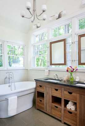 The new master bathroom is a handsome, comfortable space with classic fixtures and energy-efficient windows.