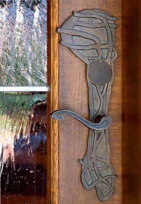 Leaning toward Art Nouveau, an artistic entry doorplate from Heritage Metalworks.
