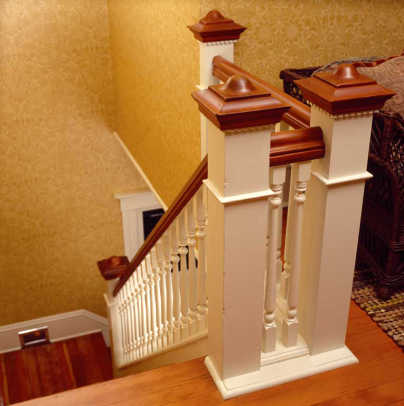 The balustrade at the top of the stairs was re-created when a later bedroom wall was removed. It combines traditional turned balusters with square-stock newel posts.
