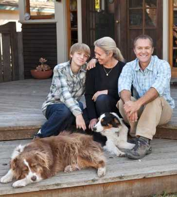 Homeowner John Bock and his wife, Diane, with son Bryan and Australian Shepherds Jenny and Sue.
