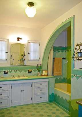 All original, this bathroom is in a 1933 Spanish-style bungalow in Pasadena. A riot of colorful tile covers floors, tub niche, and backsplash. Photo: Jaimee Itagaki
