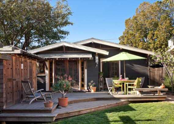 The back deck is bordered on one side by a redwood structure that houses the water heater, washer/dryer, and garden tools. The ventilation cutouts in doors were inspired by California poppies.