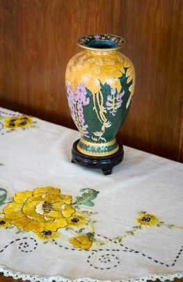 The cloisonné vase on the dining-room server is from a trip to Beijing; its wisteria is a reminder of a vine on the house.