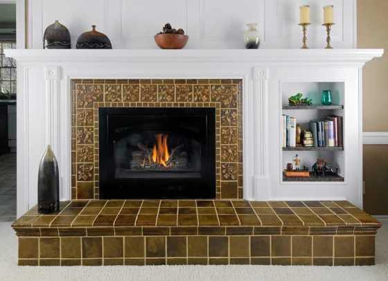 Custom dogwood tiles create a trailing motif on a fireplace surround.