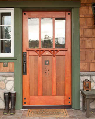 The 42-inch artistic front door, in old-growth Douglas fir with a wenge rose inlay, is a commissioned piece from ShamaWood in British Columbia.