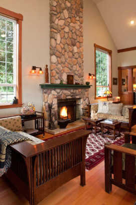 The living room features Stickley reproduction furniture and a few antiques.