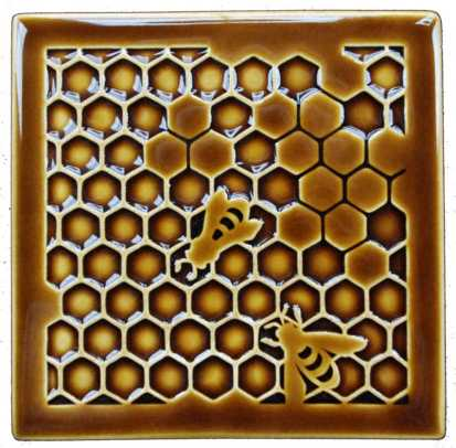 The bee tile artfully depicts bees on a honeycomb.