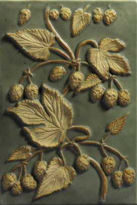 A relief tile with hop buds and leaves shows a high degree of realism.