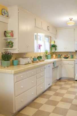 The kitchen behind the dining room got a facelift with cheery yellow countertop tiles and a commercial vinyl checkerboard floor.