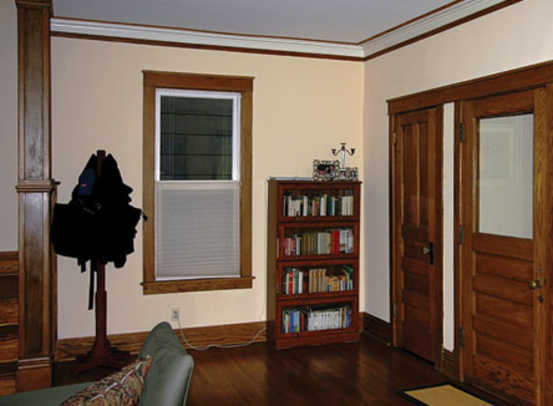 Floor, walls, and ceiling are separate entities in an entry hall with bits of unrelated furniture and little style.