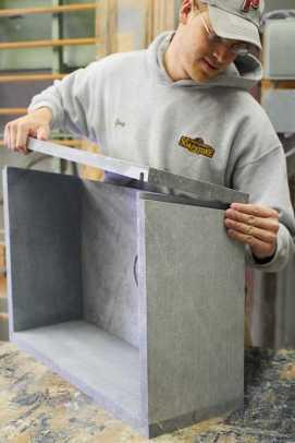 Greg Seuren, Scott's son, assembles a sink.