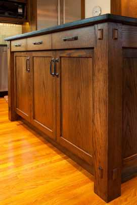 New cabinets complement the existing woodwork of the home.