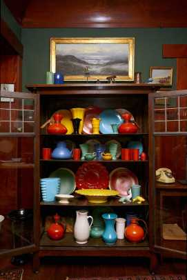 A hutch (maker unknown) displays the best-quality dinnerware in the collection that extends to the kitchen. Contents include Catalina and quite a bit of Bauer.