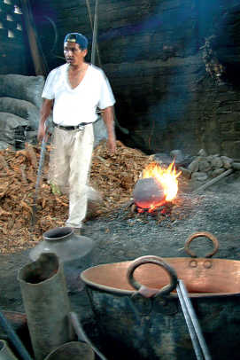 A Purepecha craftsman at the fire