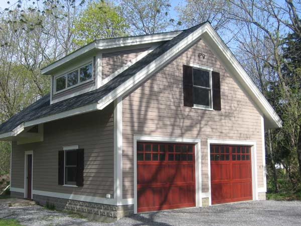 New garages that blend in arts crafts homes and the for Two and a half car garage