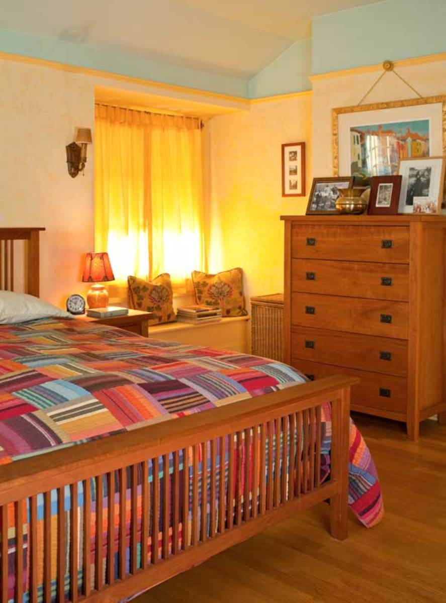 The bedroom is furnished with Arts & Crafts revival pieces in cherry.