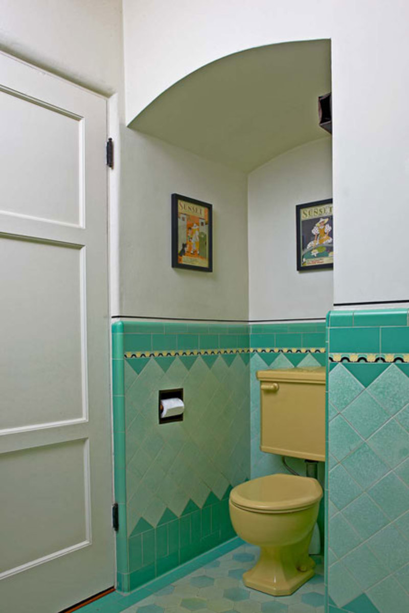 Having the toilet in its own niche is typical of these Deco bathrooms. The Sunset magazine covers on the walls date to 1933, the year the house was built.