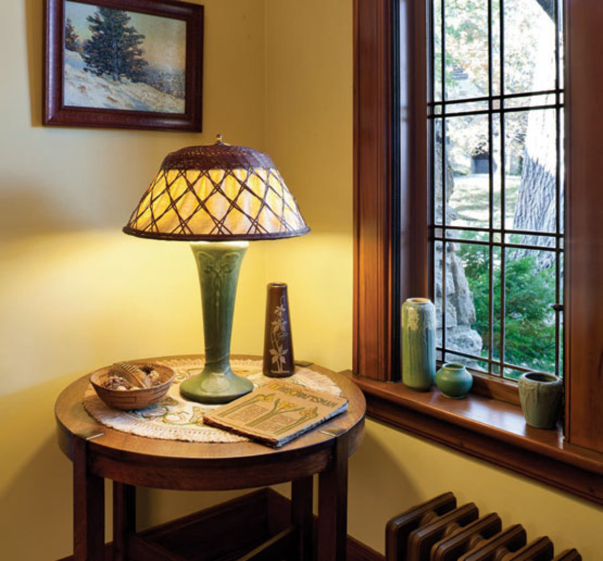 A 1910 issue of The Craftsman with objects of the period on a Gustav Stickley lamp table. Photo by Josh Beeman.
