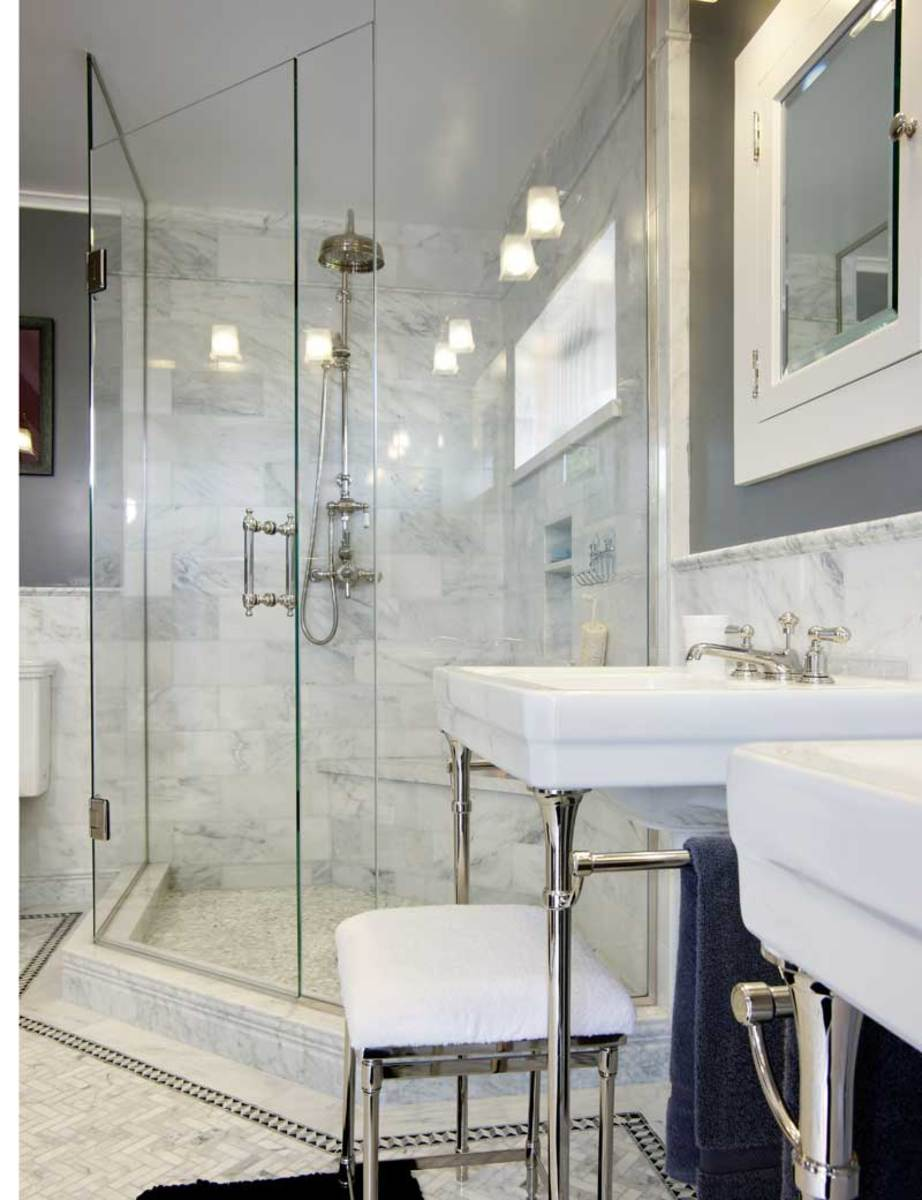 glass corner shower with Carrara marble mosaics