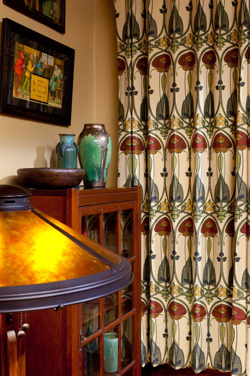 Next to treasured Taber–Prang art prints are curtains made from fabric the owners found in the Cotswolds.