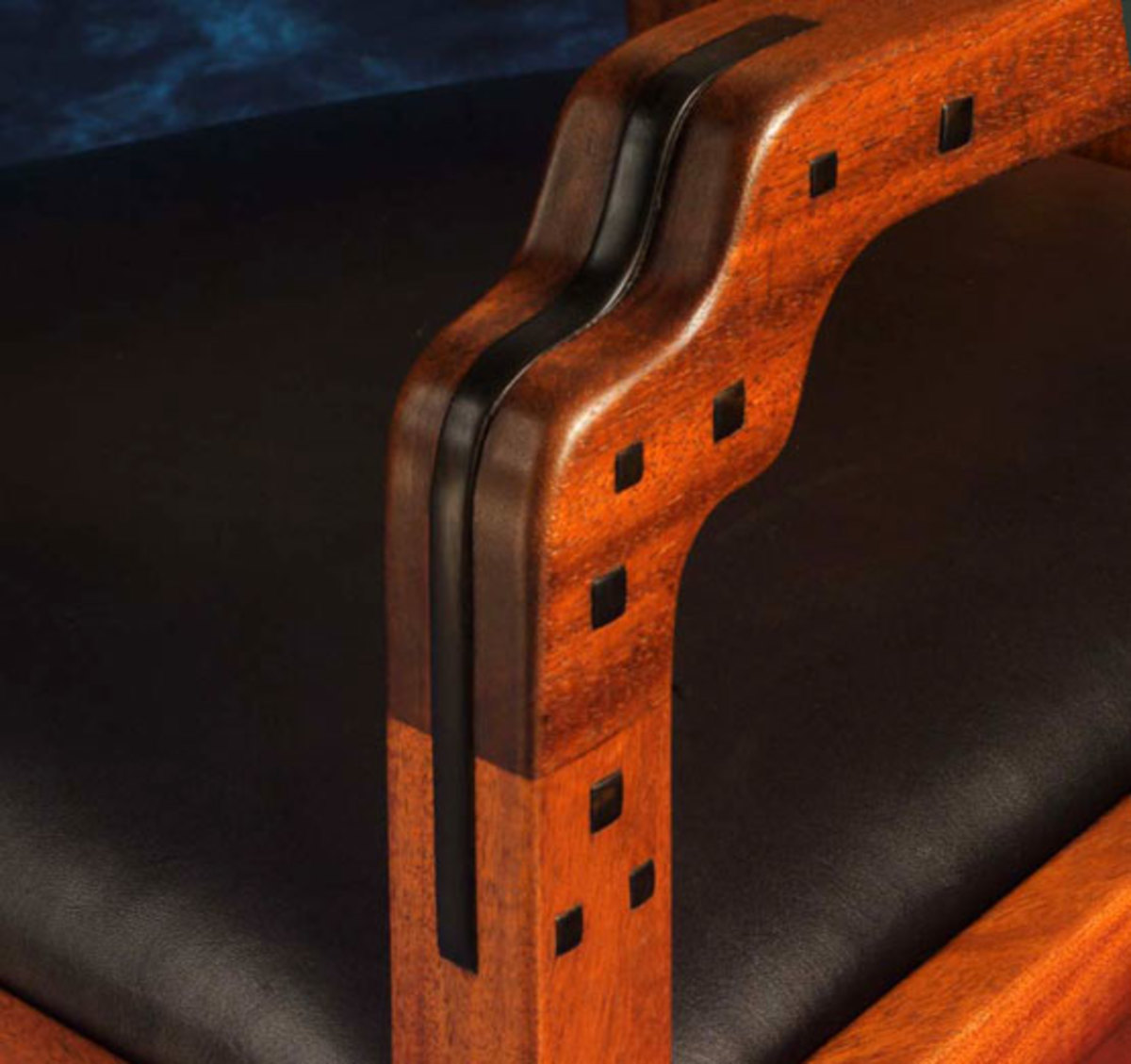 Darrell Peart's take on the Blacker House rocker incorporates S shaping to the arm, ebony plugs in varied sizes, and Blacker brackets under the seat.