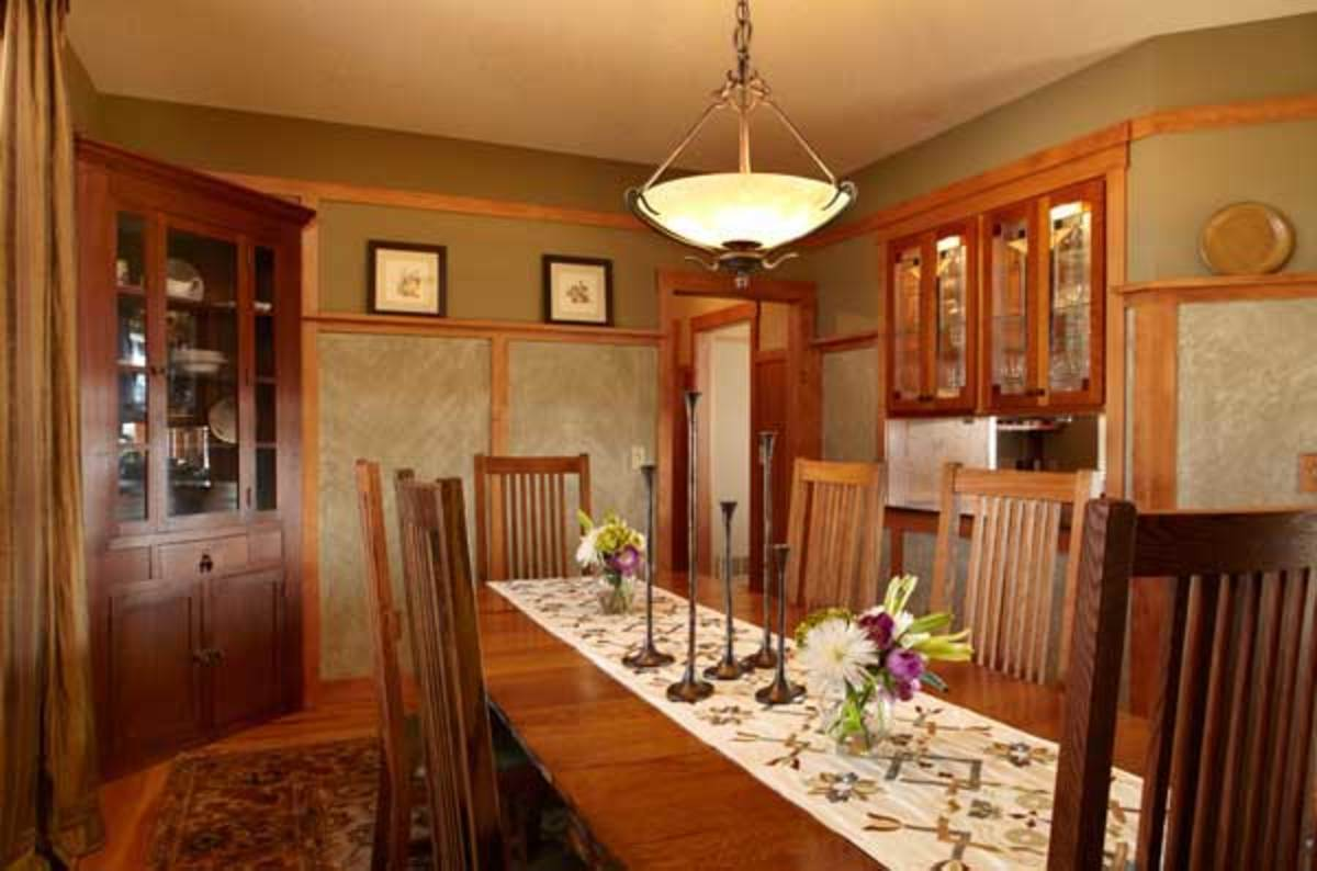 Craftsman influence is most apparent in the cozy dining room, where Brown introduced silk drapery and a custom table runner. Wainscot panels are paint ragged with cheesecloth.