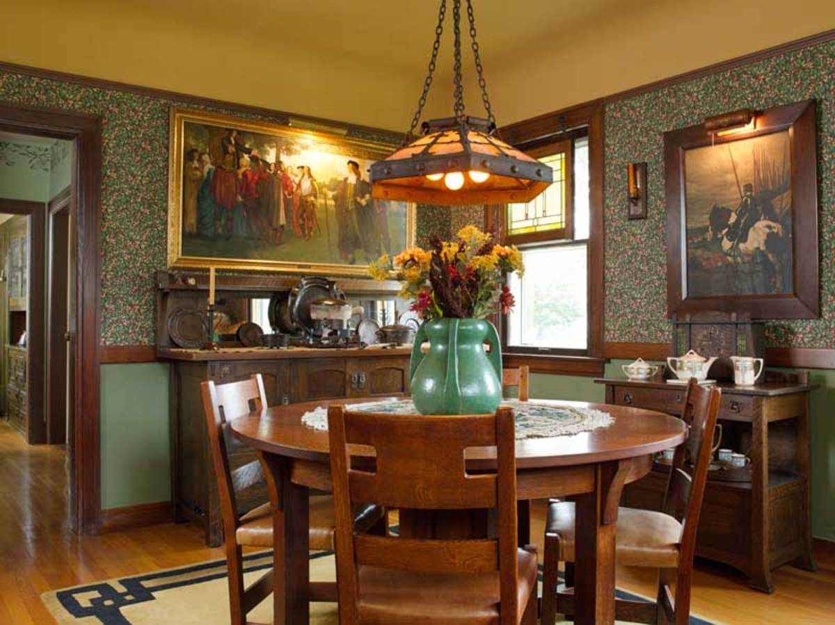 The large vase on the Limbert dining table is by Wheatley, the owner's favorite pottery.