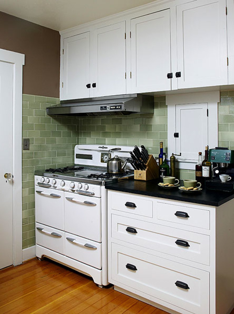 The trim white stove is vintage (1953); O'Keefe and Merritt stoves are coveted by many old-house owners. The little built-in cabinet to the right is a spice rack.