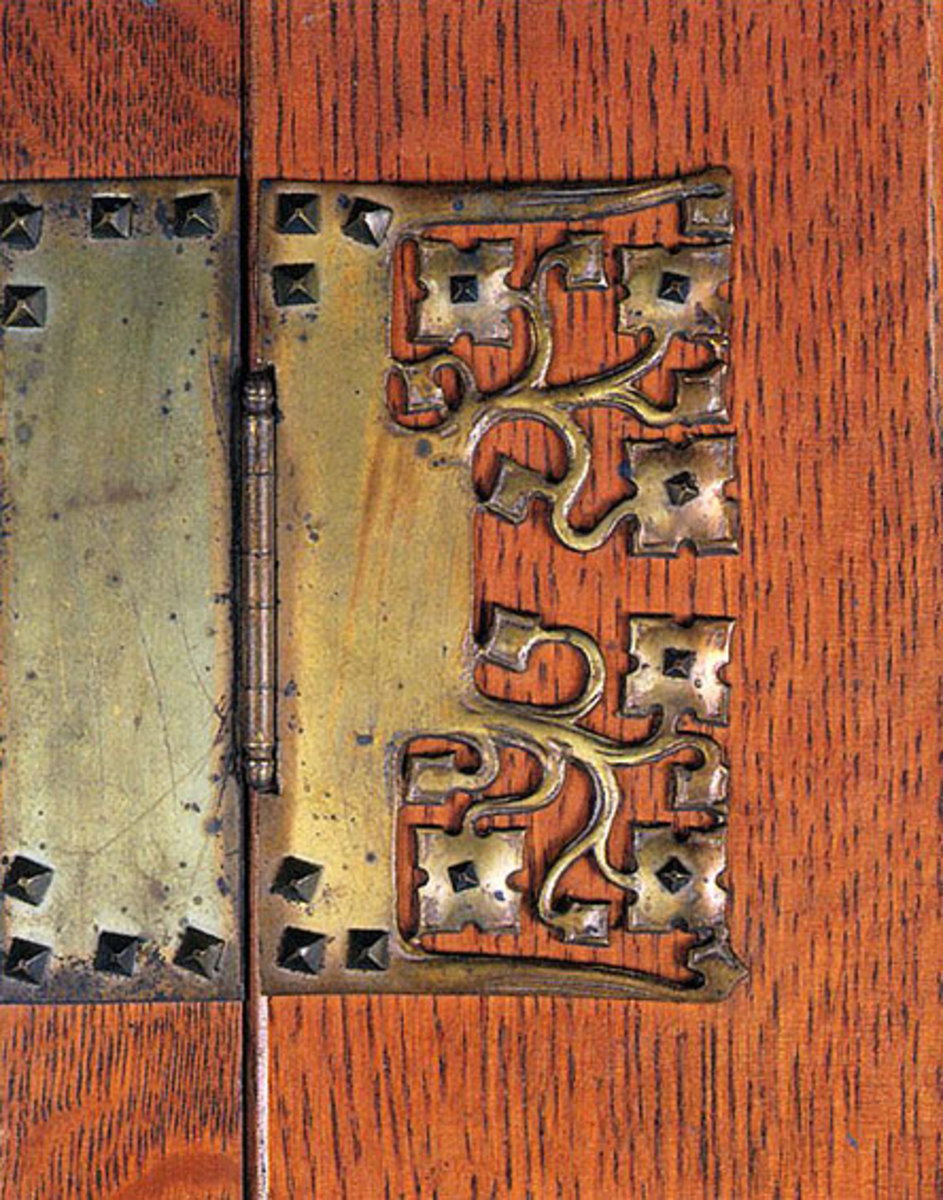 Artsy, elaborated hardware was often the only Arts & Crafts allusion on an otherwise generic Grand Rapids piece.