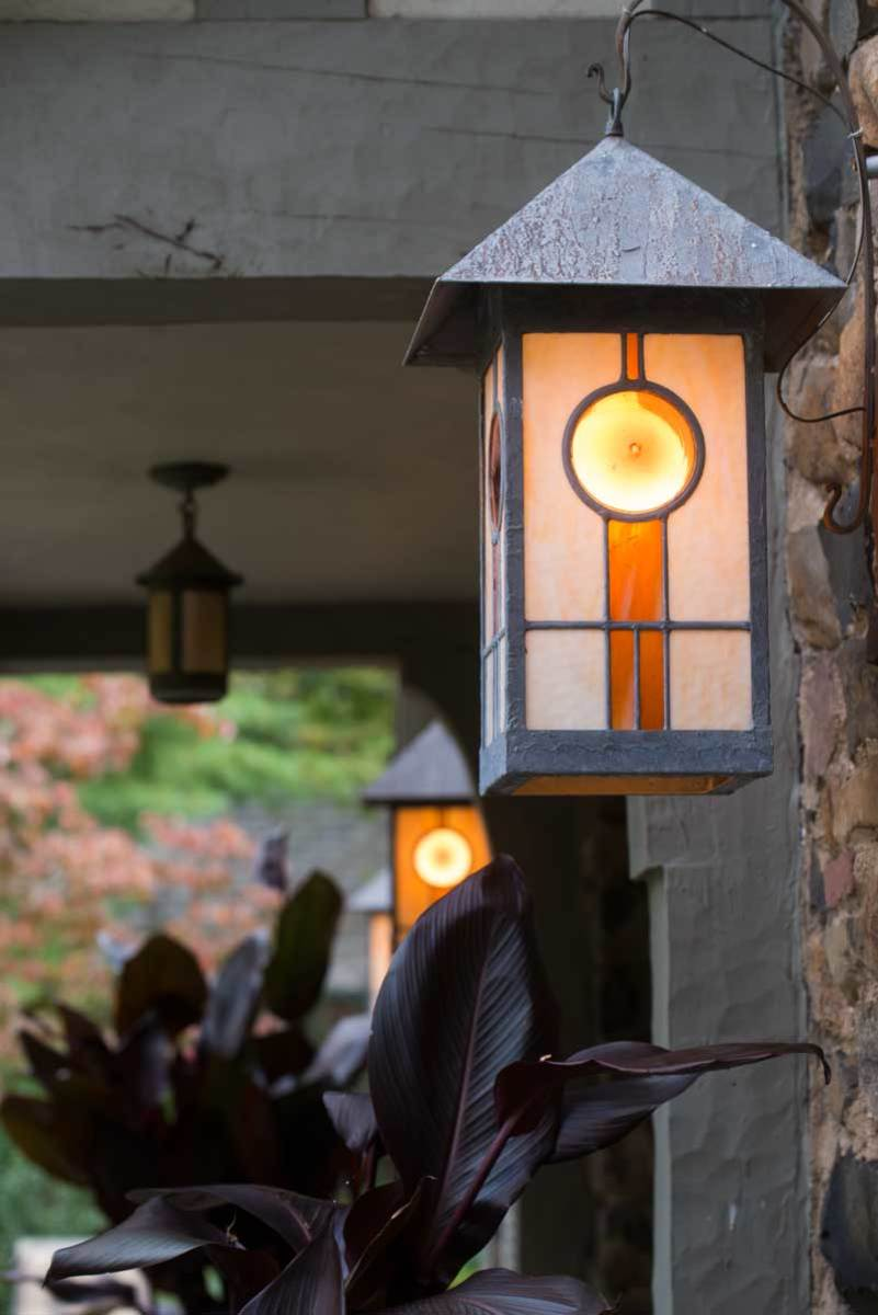 Mara Seibert designed custom Arts & Crafts lanterns for the back terrace; DeWitt Tishman Architects managed the renovation.
