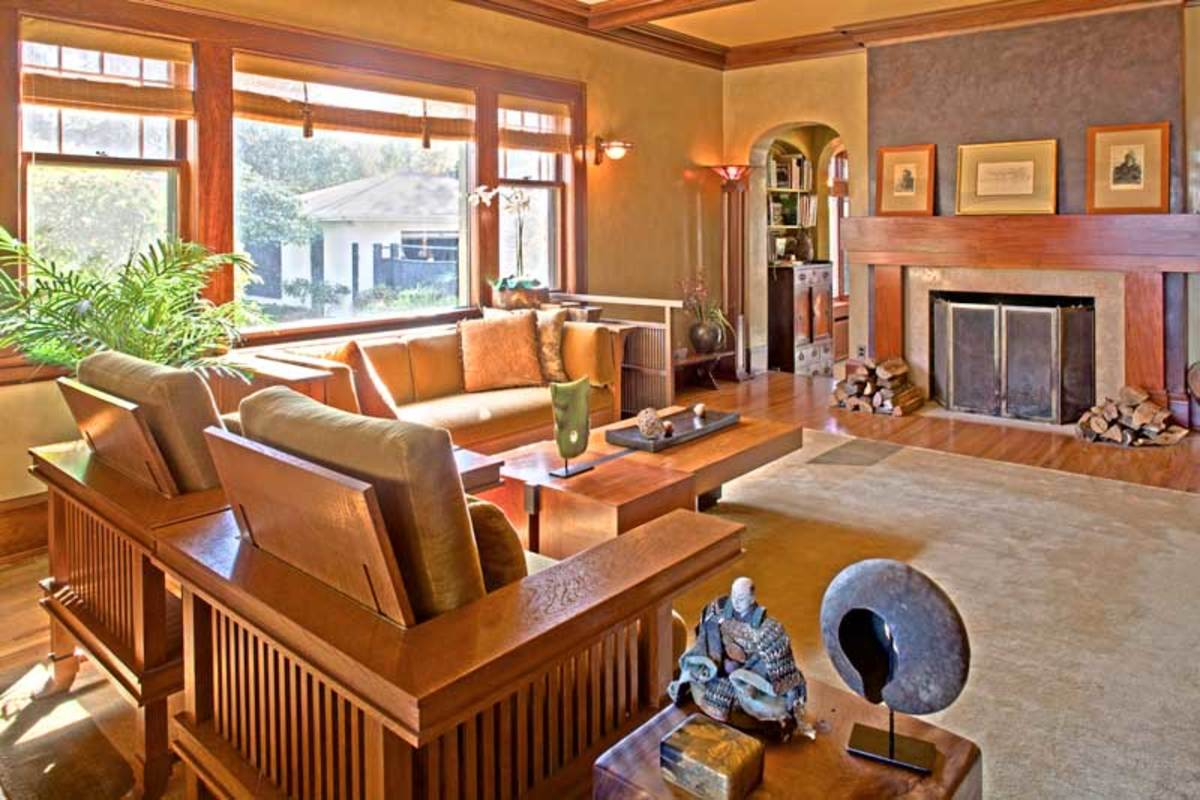 Prairie armchairs and a settle by Stickley blend with oriental antiques in the living room, with its Asian-inspired mantel. Seven coats of Venetian plaster add depth to the walls.