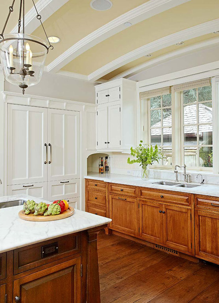 White marble countertops meet a backsplash of bevel-edged white subway tile.
