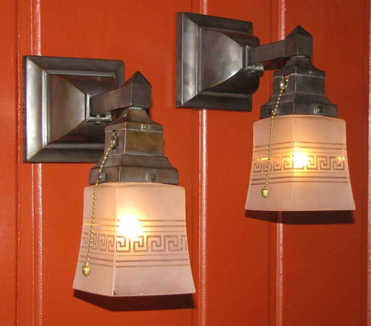 Sconces from Materials Unlimited have antique etched-glass shades.