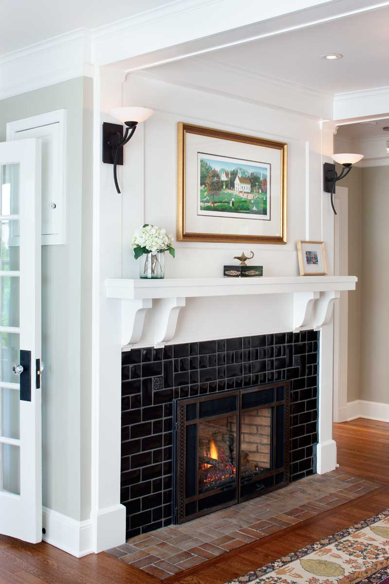 The gas fireplace is new, but the mantelshelf is original. Contemporary sconces nod to period style.