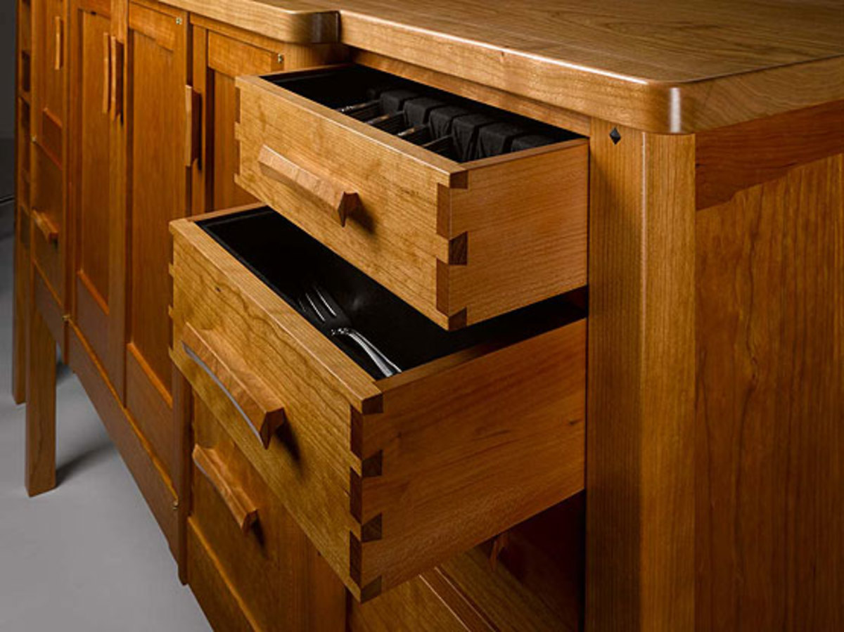 Dovetailed drawers in a sideboard are perfectly proportioned, as are the pulls.