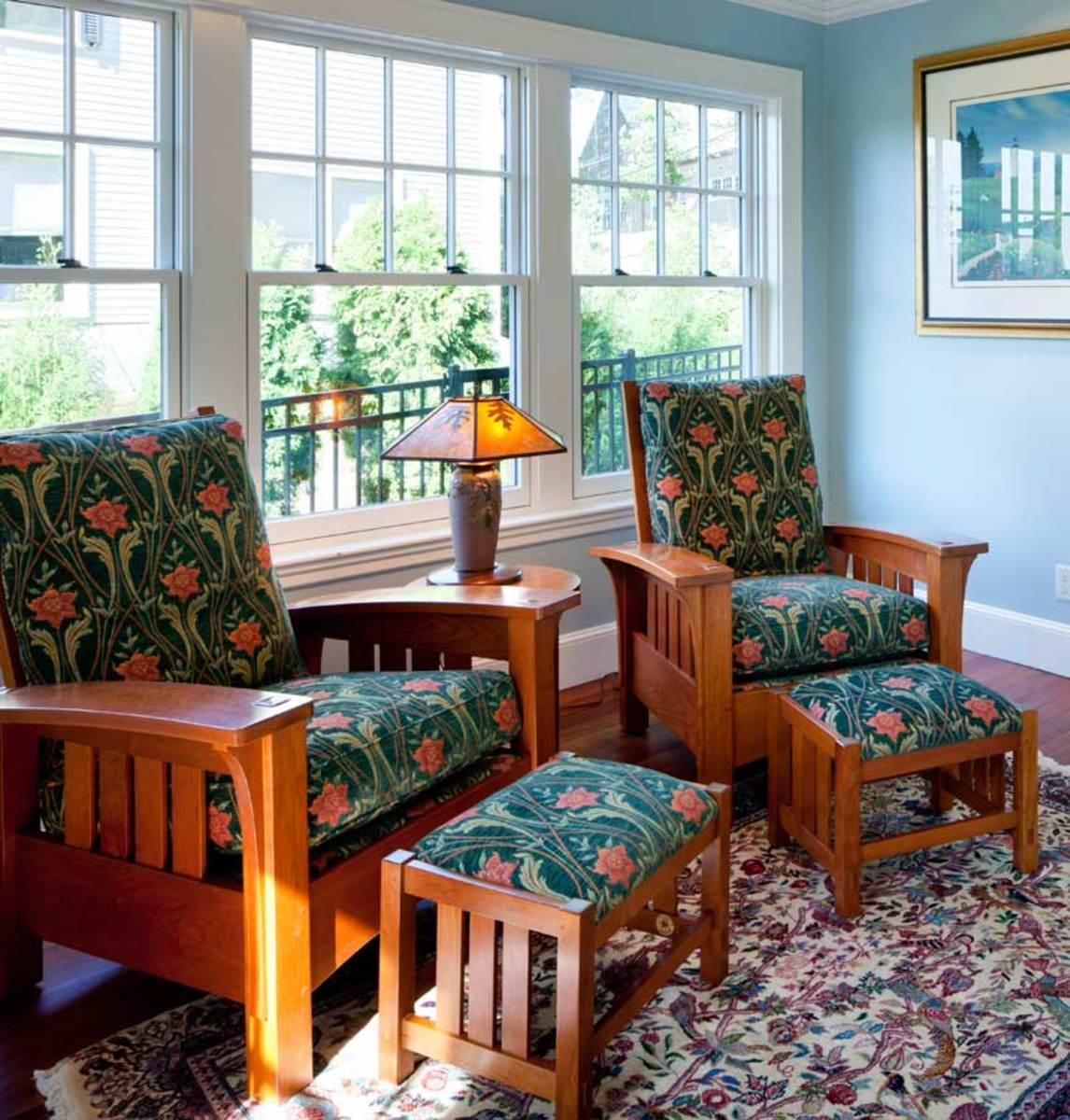 The family room is comfortably furnished with reissued pieces by Stickley.