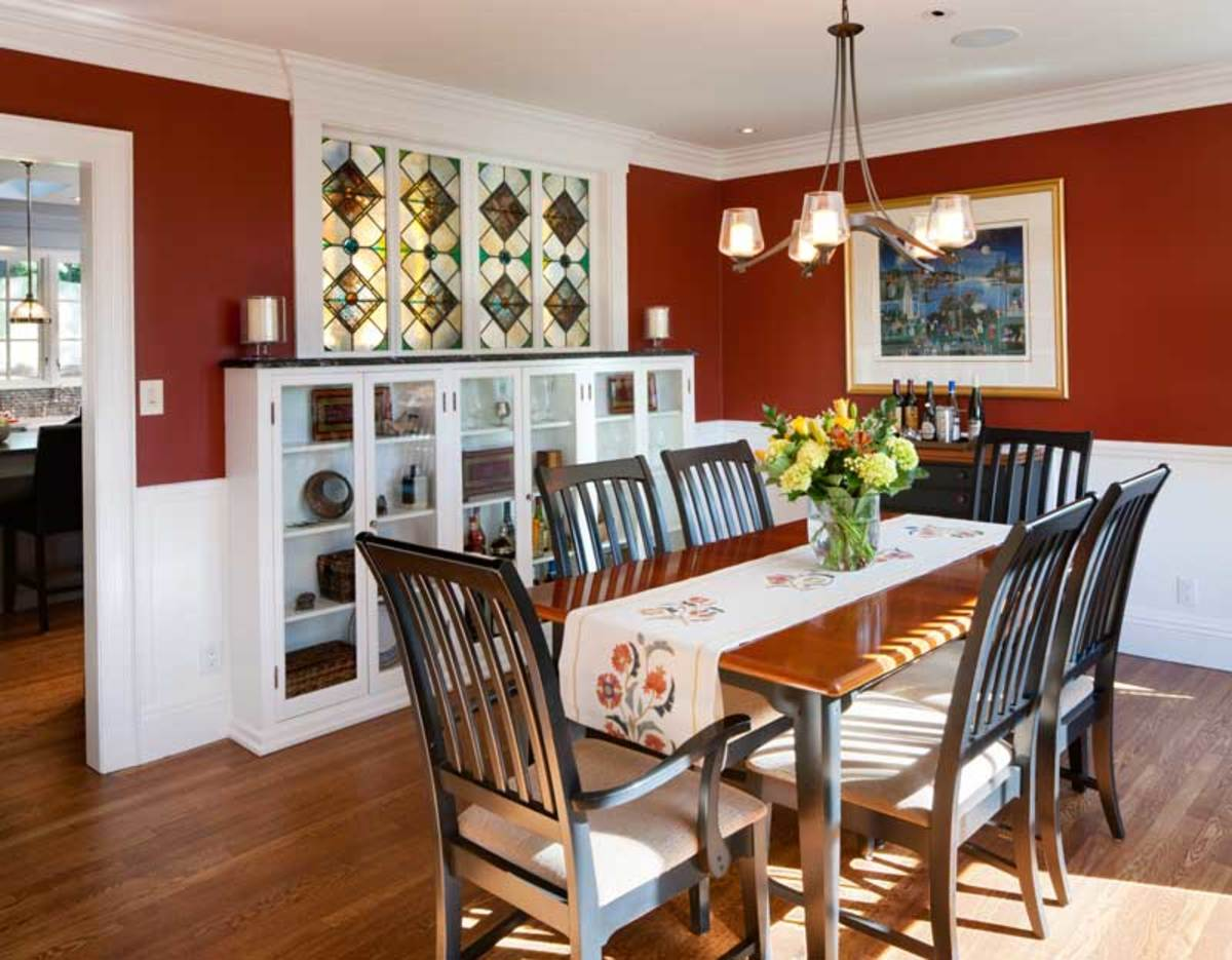 Stained-glass windows salvaged from a church allow light to pass from dining room to kitchen.