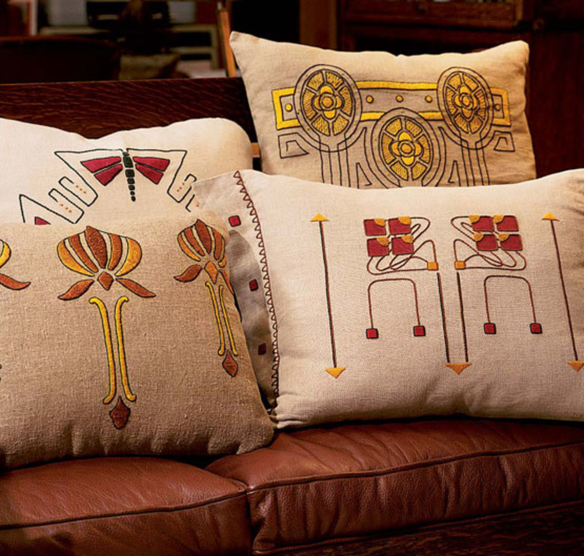 Vintage and new together: the 'Dragonfly' and 'Checkerberry' designs are new from Arts & Crafts Period Textiles, lotus blossom and yellow medallion designs are old. Photo by William Wright.