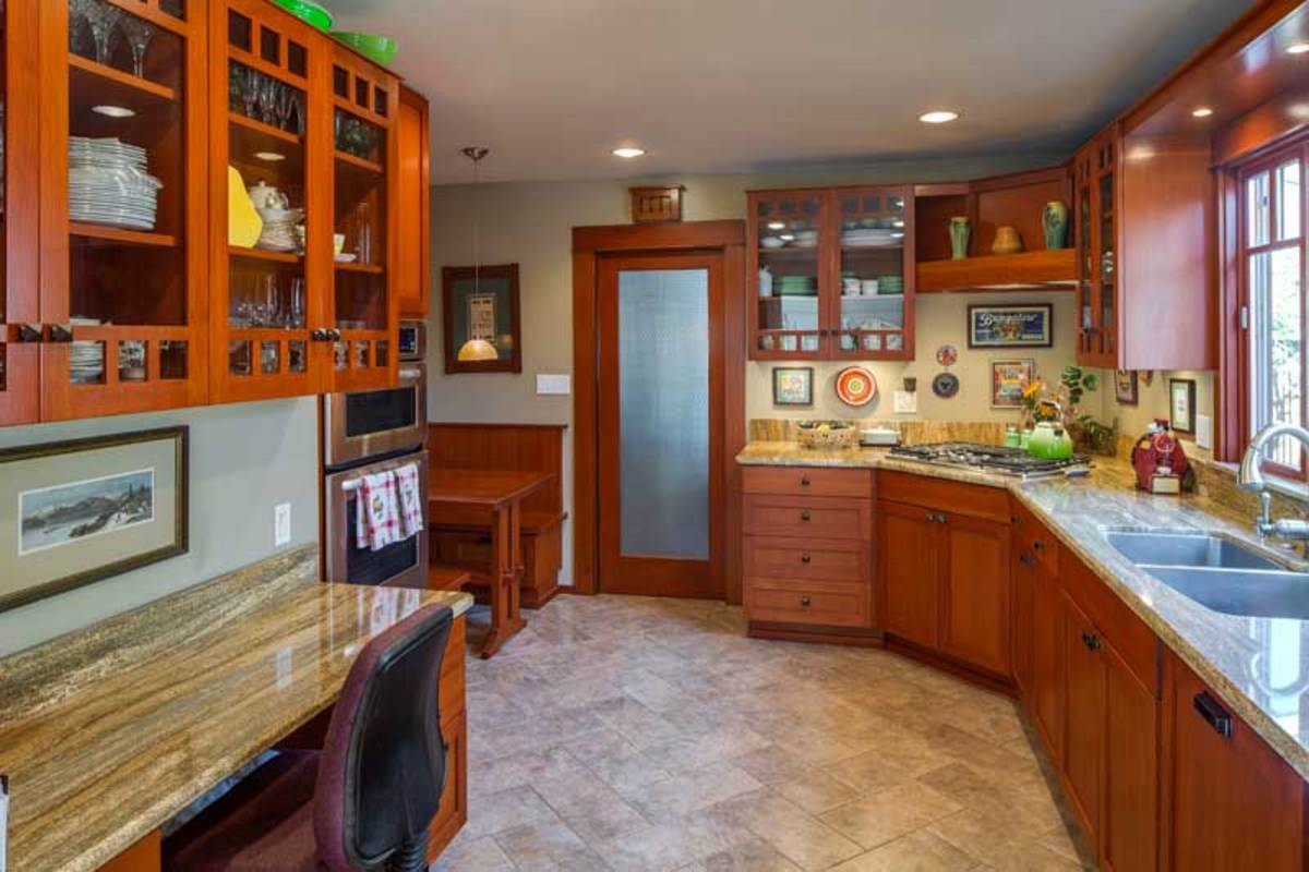 The cozy kitchen features new Douglas fir cabinets.