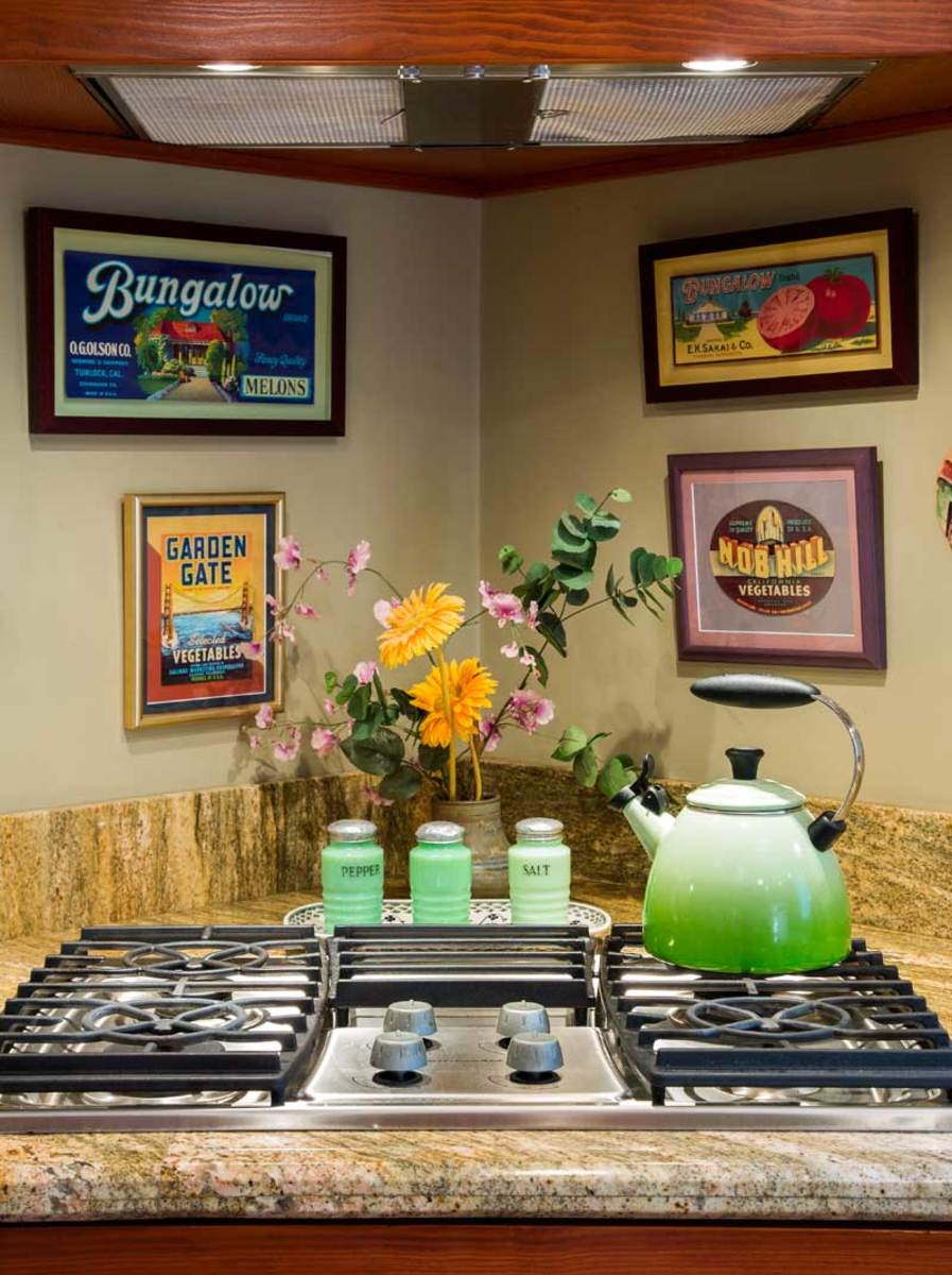 Framed vegetable and fruit labels are vintage, as are Jadeite salt and pepper shakers.