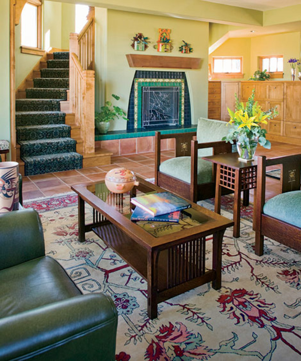 Furniture, including Harvey Ellis chairs, are re-issues by Stickley [www.stickley.com]. The arch motif repeats in the fireplace faced with  Motawi tiles.