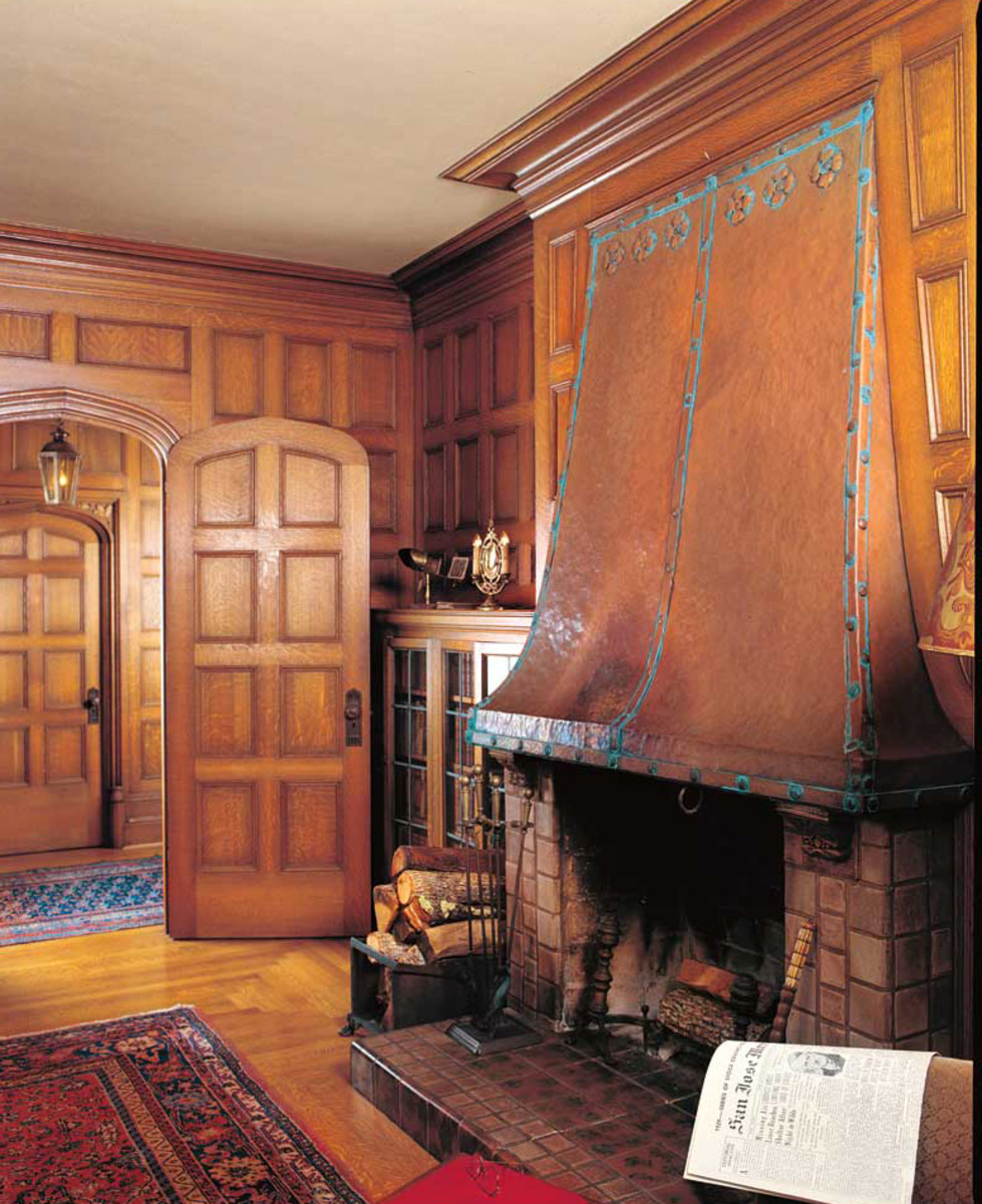 The tall, tapering copper hood is original in the study of the Tudor Revival Ainsley House (1925), which also boasts Batchelder tiles and Dirk Van Erp lamps in its Arts & Crafts/Tudor interior. Photo: Mark Lazzarini