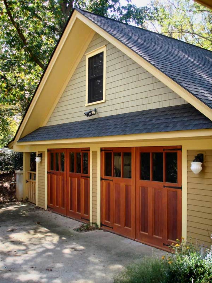 New garages that blend in arts crafts homes and the for Garage style homes