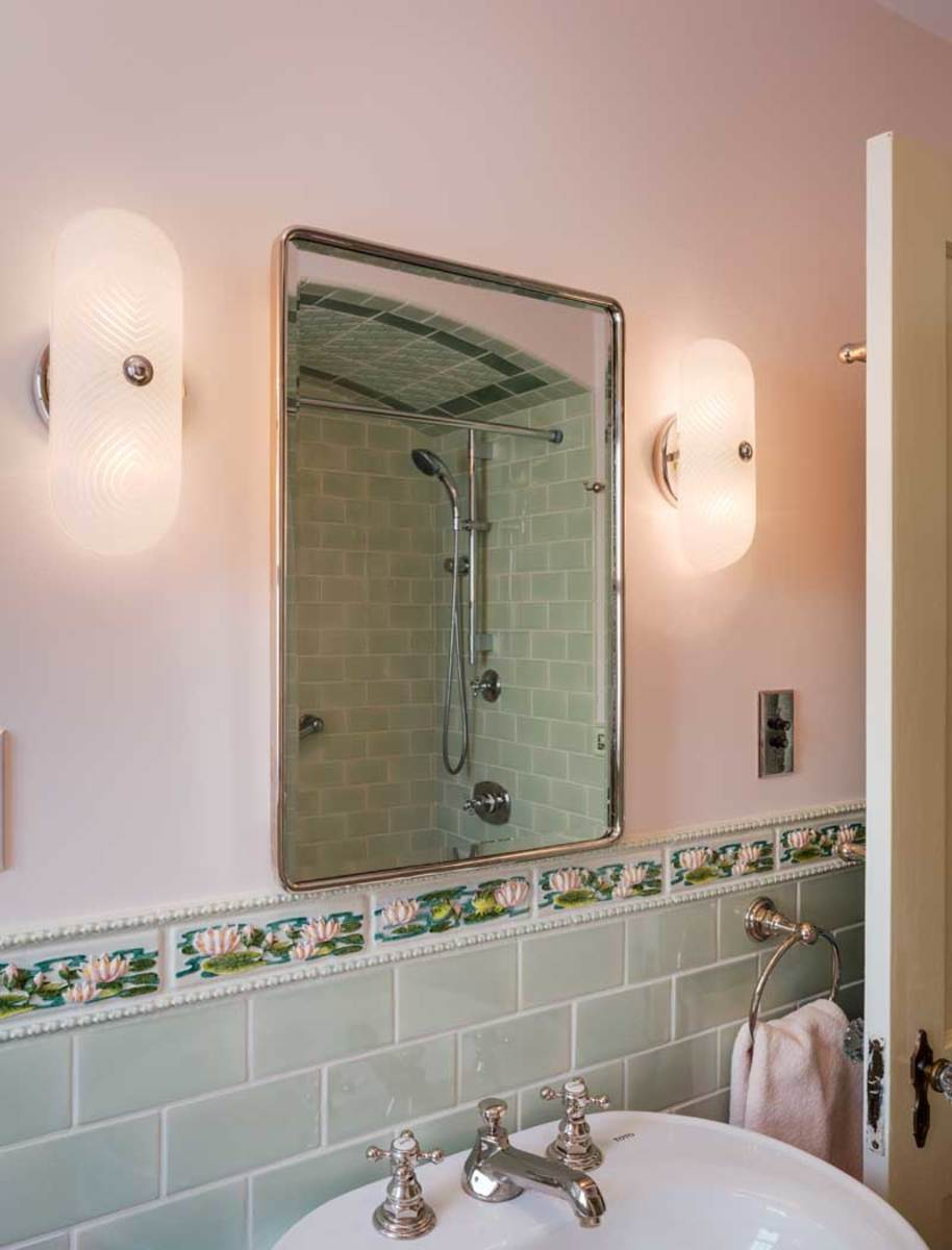 The antique sconces and pottery barn mirror are period perfectg dailygadgetfo Choice Image