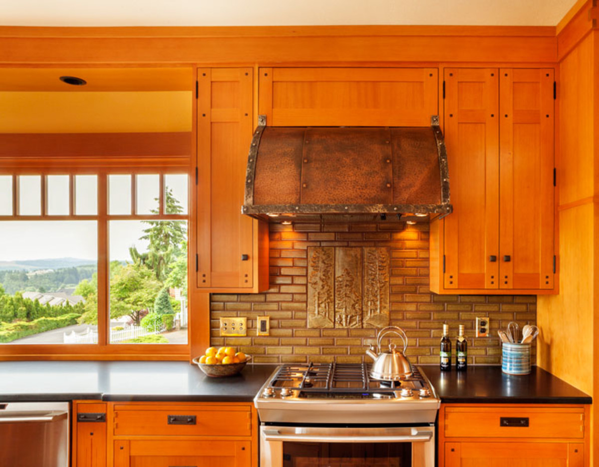 North Prairie Tileworks created the decorative backsplash. Banks of cabinets create a pantry that looks like furniture.