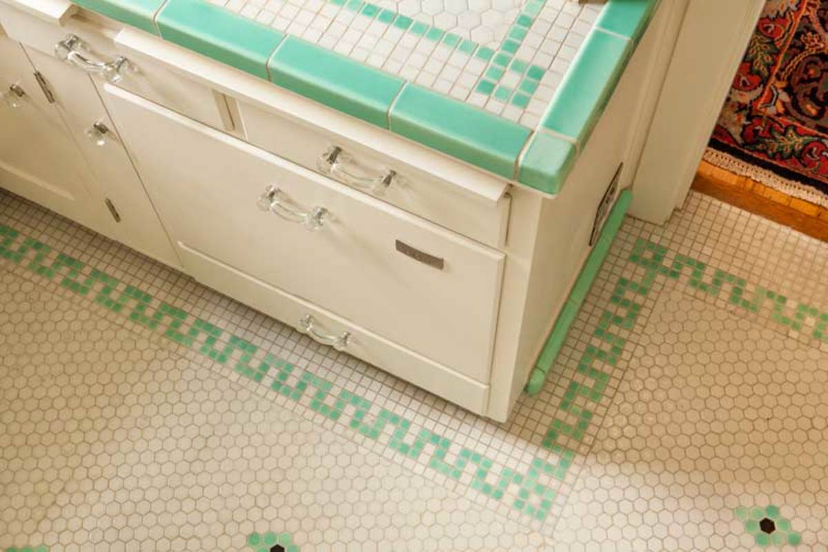 The counter top and floor tiles were installed in the 1930s. The deep bin drawer now houses a dishwasher.